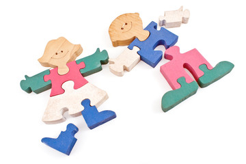 Colorful wooden girl and boy puzzle pieces isolated on white