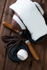 American football with a towel, jumping rope and a baseball ball