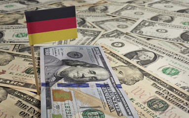 Flag of Germany sticking in various american banknotes.(series)