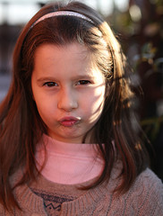 italian child angry with a wool sweater