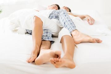 Intertwined Legs Sleeping Couple