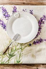 Plate and fork on vintage wooden dining table