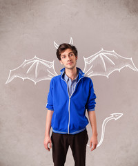 Young man with devil horns and wings drawing