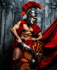 Roman warrior with muscular body holding sword and shield