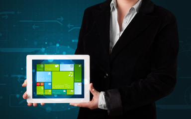 Lady holding tablet with modern software operational system