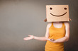 Young lady gesturing with a cardboard box on her head with smile