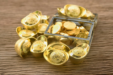 Pile of chinese gold ingots and golden coins