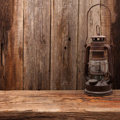 lamp oil lantern retro barn wooden background