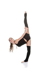 young woman exercising ballet stretches