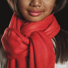 Portrait of a girl in a red scarf around his neck close-up