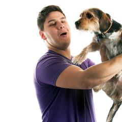 Man Holding His Pet Dog