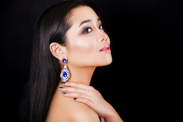 beautiful brunette asian model with luxury accessories.