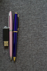 Pair of Pens and Flash Drive.