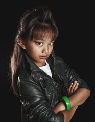 Asian girl with trendy rock hairstyle, in a leather jacket