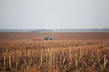 Tractor plows autumn field