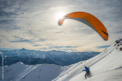 Canvas Luchtsport Paraglider launching from snowy slope