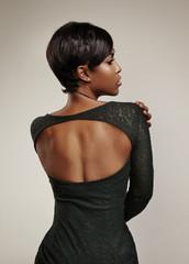 woman's back wearing green evening dress. Open back.