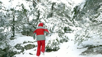 Adult man in red walking on mountain forest