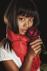 girl of Asian ethnicity in a red scarf with burgundy rose