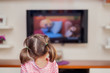 canvas print picture - little cute girl watching tv
