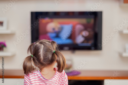 canvas print picture little cute girl watching tv