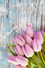 Pink tulips on wooden planks