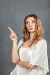 Young woman showing disapproval with finger