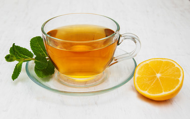 Cup of tea with lemon and mint