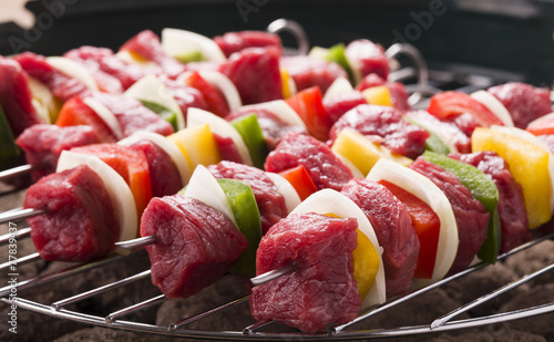Raw beef skewers ready for grilling - 77839437