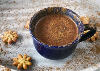 Kakao with cinnamon and cookies