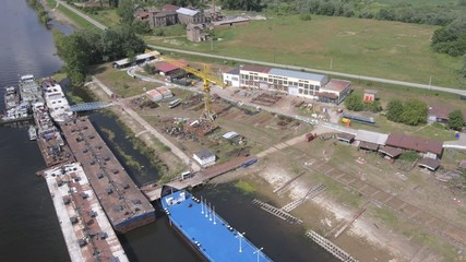 Aerial view on small shipyard and old rusty tankers.