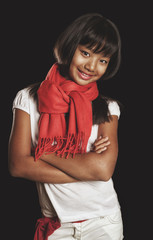 tanned smiling girl of Asian appearance in a red scarf
