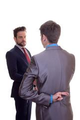 business men fingers crossed because of hope or lie