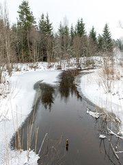 winter rural scene with fog and frozen river