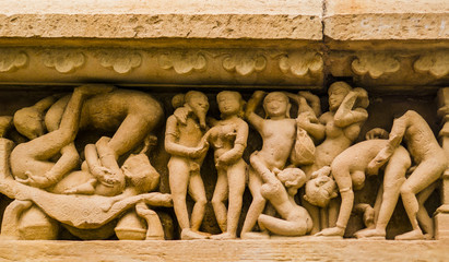 Stone carved erotic sculpture in Khajuraho temple, India