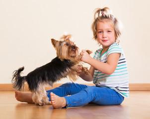 Child holding Yorkshire Terrier