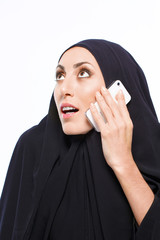Beautiful Muslim woman holding a cellphone