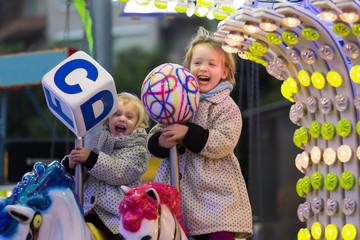 Happy children  at carousel in park