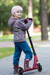 Little girl with scooter in park