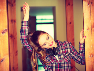 Teen girl in headphones listening music