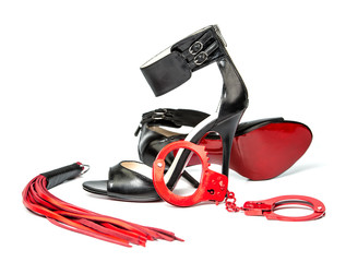 Fetish stuff: High Heels, leather whip and hand cuffs