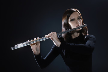 Flutist playing flute music instrument
