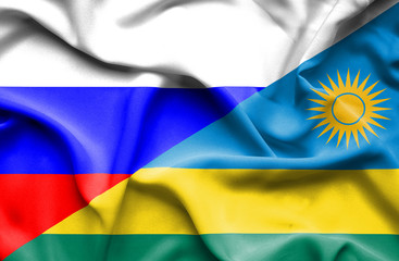 Waving flag of Rwanda and Russia
