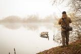 Fisherman on the autumn background.