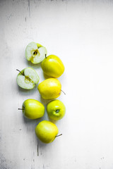 Bright apples on white wooden background