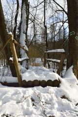 Snowy footbridge over the river