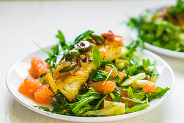 Grilled fish with arugula salad
