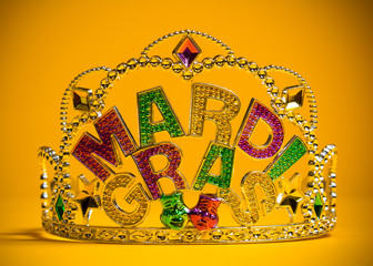Jeweled Mardi Gras crown on a yellow background