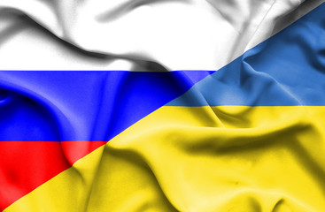 Waving flag of Ukraine and Russia