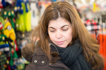 Middle Age Woman Browsing a Store